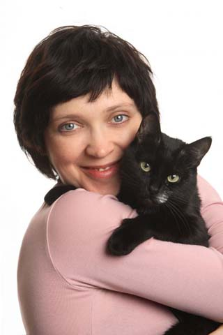 cat and owner in pink jumper
