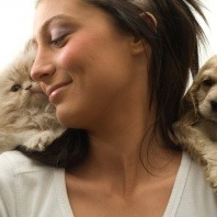 lady with kitten and puppy